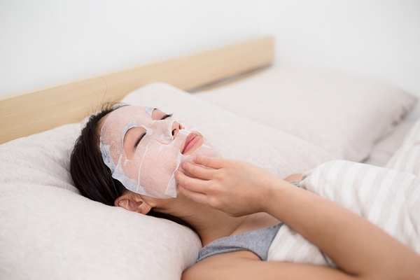 Apply an overnight face mask for clear skin.